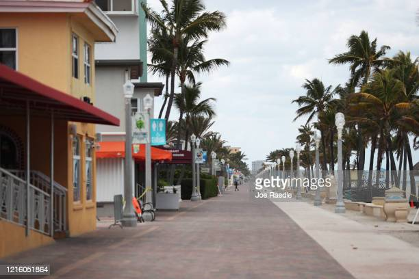 The boardwalk that runs along the beach and is normally filled with people is seen on March 31, 2020 in Hollywood, Florida. The City of Hollywood...