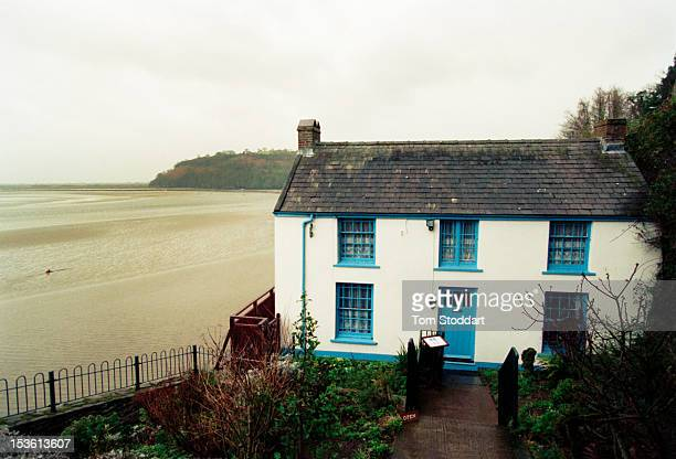The Boat House in Laugharne Wales where Welsh poet and writer Dylan Thomas lived with his wife Caitlin and their three children during the last four...