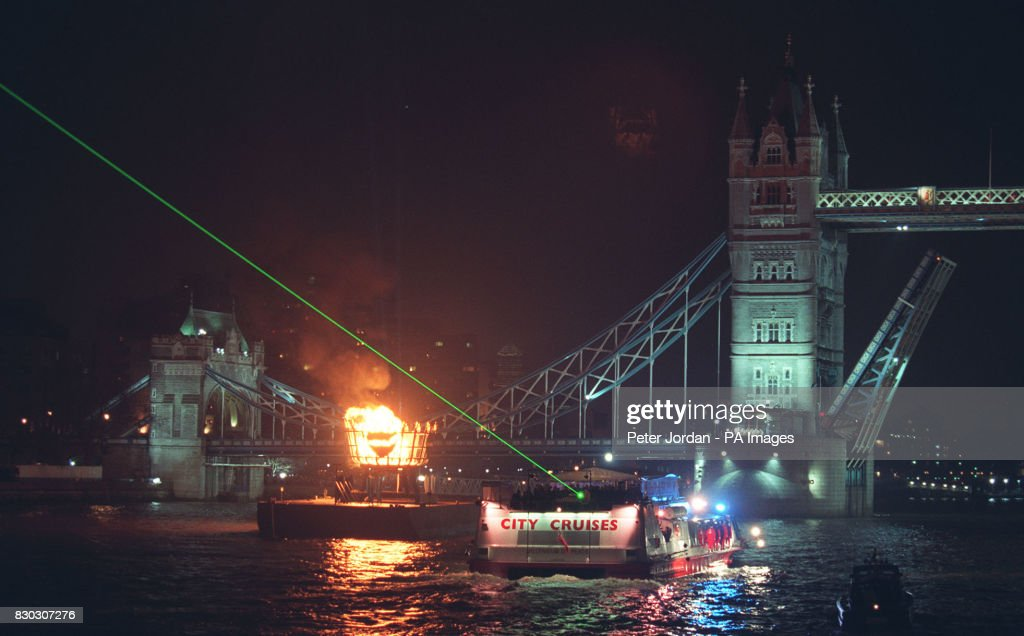The boat Millennium of Peace carrying The Queen and Duke of Edinburgh along the Thames & The boat Millennium of Peace carrying The Queen and Duke of ...