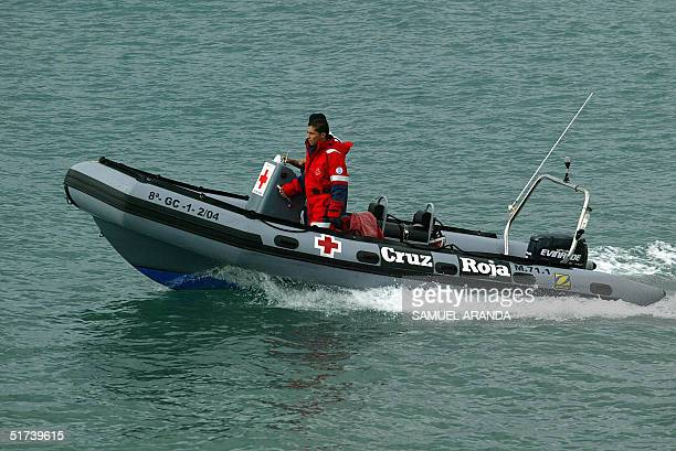 The boat of the International Red Cross searches 14 November 2004 t for he bodies of the seven illegal immigrants drowned yesterday in the coast of...