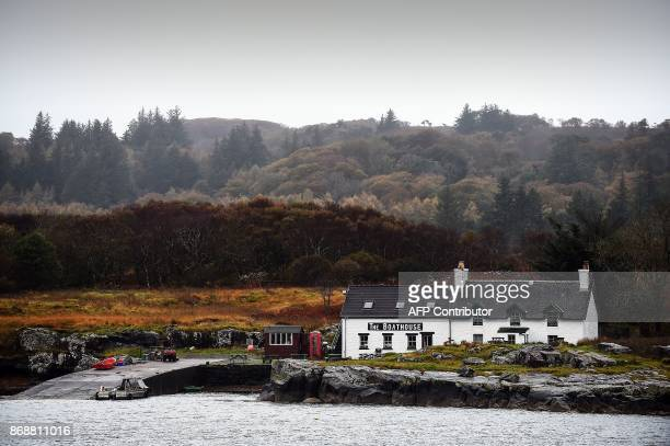The boathouse cafe is seen across the water on the Isle of Ulva off Scotland's west coast on October 20 2017 When tycoons in helicopters began...