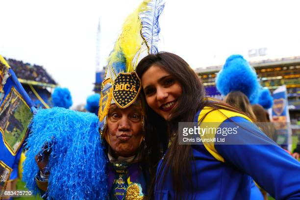 The Boca Juniors mascot poses with a cheerleader ahead of the Torneo Primera Division match between Boca Juniors and River Plate at Estadio Alberto J...