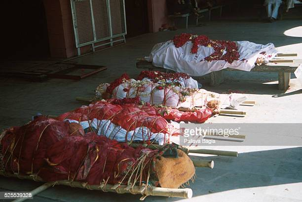 The bodies are prepared before cremation in the town of Ahemdabad