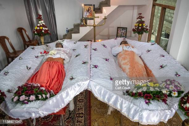 The bodies of 12 year old Jiyasha Sheshani Janz and her mother Dineesha Geethani de Vaas lie in their house during a wake after they were killed by a...