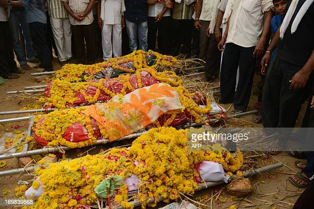 The bodies of 38 year old Indian woman Alka her son Yash 13 daughters Krishna 17 and Pinkle 16 are draped in flowers near their house before being...