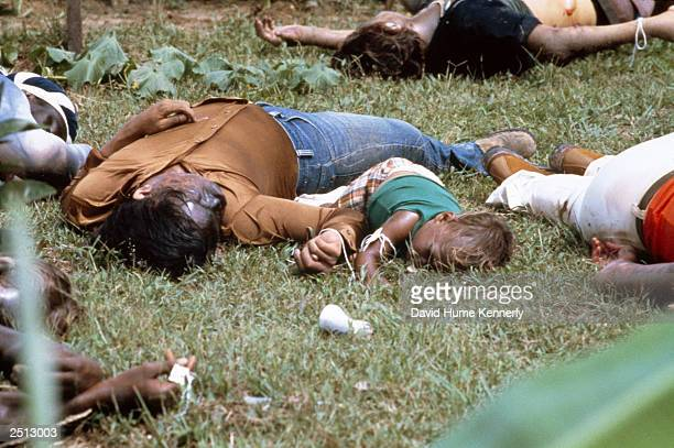 The bodies of a mother and child lie among the dead near the compound of the People's Temple cult November 18 1978 in Jonestown Guyana after over 900...