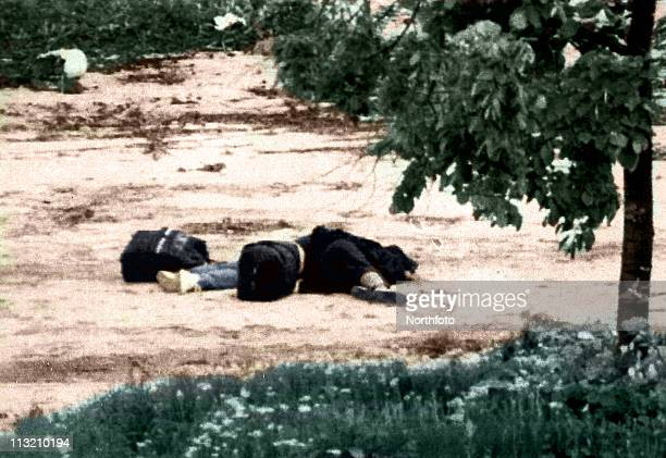 The bodies of Admira Ismic right and Bosko Brkic lie near the Vrbanja bridge in Sarajevo Bosnia on Wednesday May 19 1993 Admira a Moslem and Bosko a...