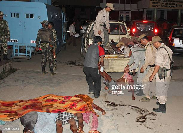 The bodies of blast victims are unloaded from a truck at a hospital in Imphal the capital of Indias northeastern state of Manipur late on September...
