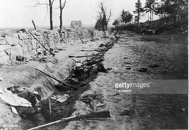 The bodies of Confederate soldiers in a trench behind a stone wall photographed by Mathew Brady at Fredericksburg Virginia USA circa 1861