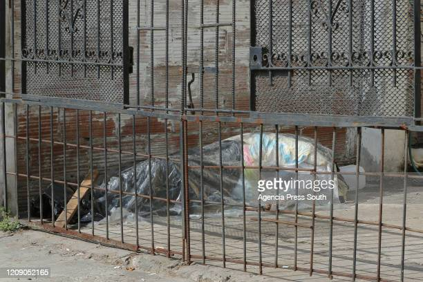The bodies of coronavirus victims are packed and placed at the entrance of a house until the police carry out the survey on April 3 2020 in Guayaquil...