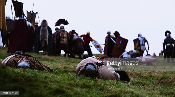 The bodies of 'dead Barbarians' lie on the battlefield during a skirmish as the lives of Roman Legionnaires are reenacted during the Hadrian's Wall...
