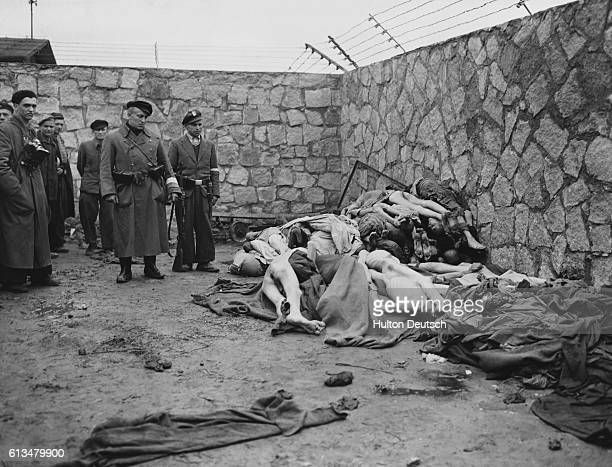 The bodies of dead prisoners are heaped on the ground at Mauthasen concentration camp near Lintz in Austria