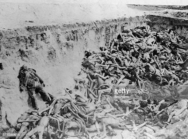 The bodies of hundreds of slave laborers of all nationalities were found here in conditions almost unrecognizable as human These pitiful remains...
