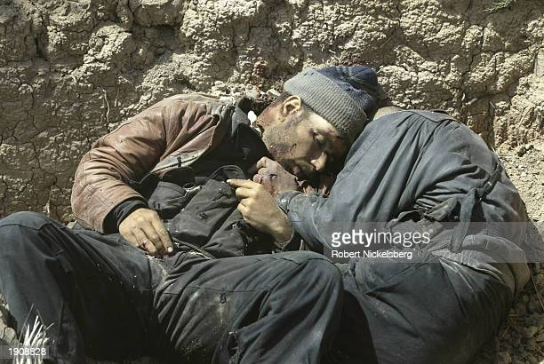 The bodies of Iraqi army POWs lie in the dirt after they were taken and killed in an ambush April 3 2003 as the US Marines entered the western parts...
