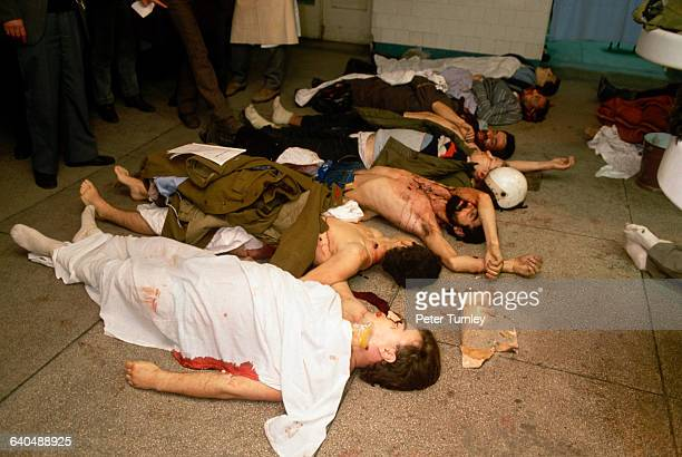 The bodies of men all bearing multiple gunshot wounds lie stretched out on the floor of the Bucharest Emergency Hospital in December 1989 They may...