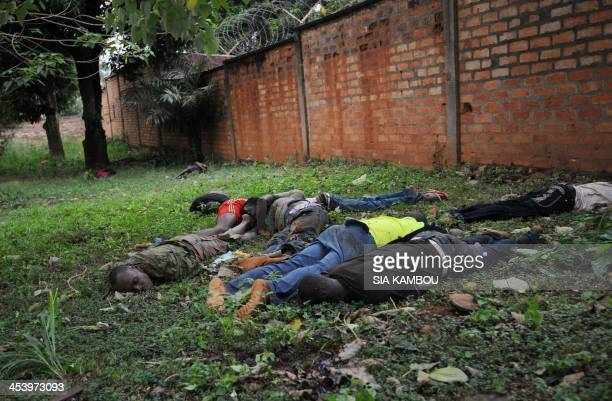 The bodies of men killed during recent clashes in Bangui remain outside a base of exSELEKA rebels on December 6 2013 French troops have killed...