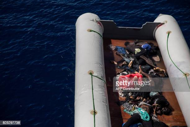TOPSHOT The bodies of migrants lie on a boat after being recovered by Santa Lucia merchant ship in the Mediterranean Sea 20 nautic miles from the...