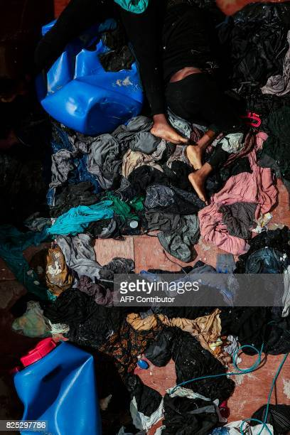 The bodies of migrants lie on a boat after being recovered by Santa Lucia merchant ship in the Mediterranean Sea 20 nautic miles from the Libyan...