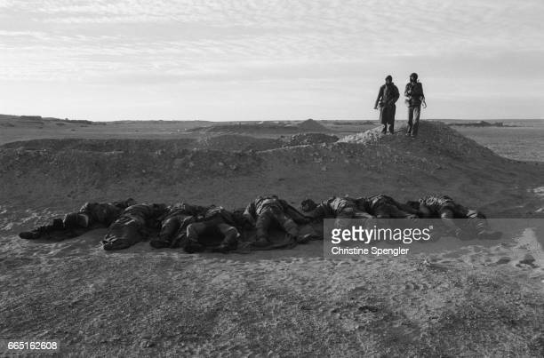 The bodies of Moroccans killed during conflict with the Polisario Front lie in the desert sand in Mahbes Western Sahara The Polisario is an army...