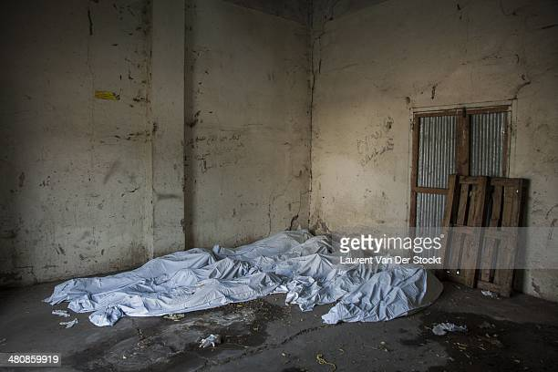 JANUARY 30 2014 The bodies of nine patients moved in a room while waiting for to be buried after being killed at the hospital of the city Employees...
