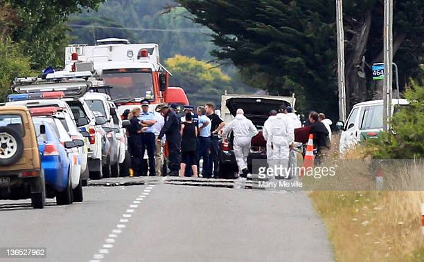 The bodies of one of the crash victims is removed from the accident site by the Police on January 7 2012 in Carterton New Zealand Emergency services...