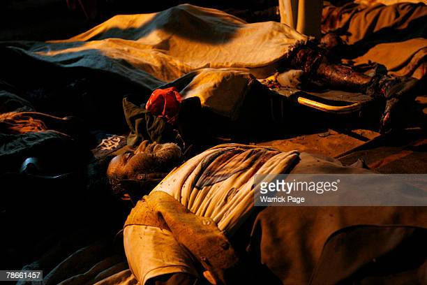 The bodies of Pakistan People's Party supporters lay in the mortuary of the Rawalpindi District Hospital on December 27 2007 in Rawalpindi Pakistan...