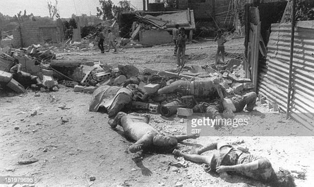 The Bodies of Palestinian refugees killed in the Palestinian refugee camp of Sabra in West Beirut lie amid rubble 19 September 1982 two days after...