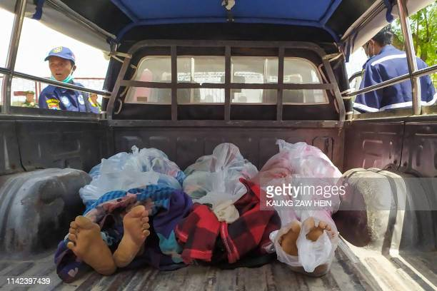 The bodies of prisoners are seen in the back of a vehicle after a riot in the Shwe Bo prison in Sagaing region on May 9, 2019. - Four prisoners were...