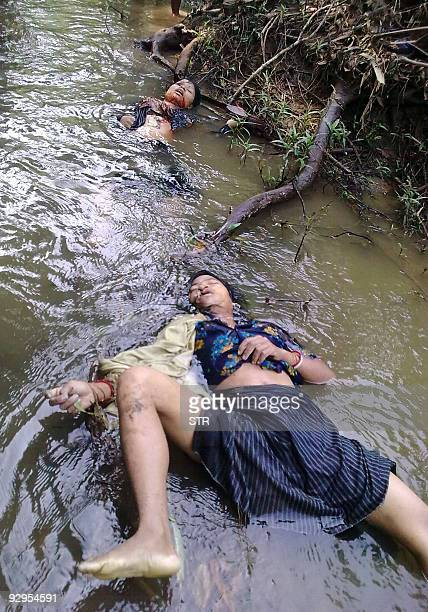 The bodies of Reang tribals believed to have been shot by suspected National Liberation Front of Tripura militants in the early morning lie in water...