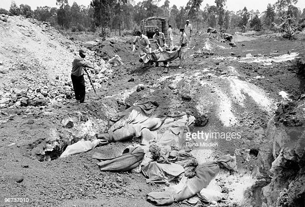 The bodies of refugees who survived the 1994 Rwandan genocide but later died following a deadly outbreak of cholera are buried in mass graves near...