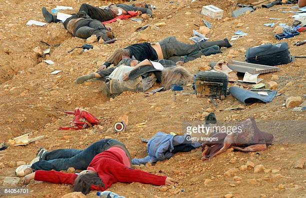 OUT*** The bodies of Russian tourists lie strewn down a slope at the scene of a tragic bus accident on December 16 2008 north of the Red Sea resort...