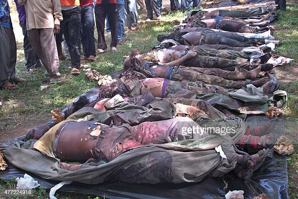 The bodies of Shebab militants killed following a botched raid on a Kenyan military barracks near Lamu are displayed on June 15 2015 A British...