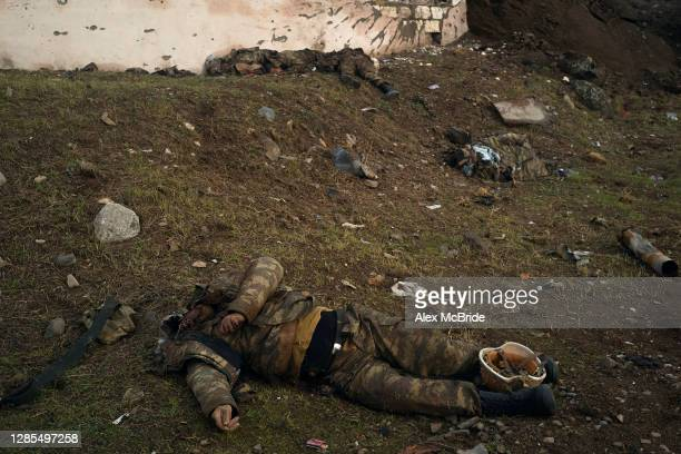 The bodies of soldiers who had been killed fighting for Azerbaijan lie on the side of the road where the final days of battle had unfolded between...
