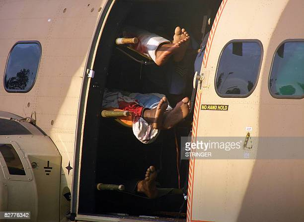 The bodies of some 11 Kenyan army officers are loaded onto a military helicopter September 11 2008 following a road accident near Thika town about 40...