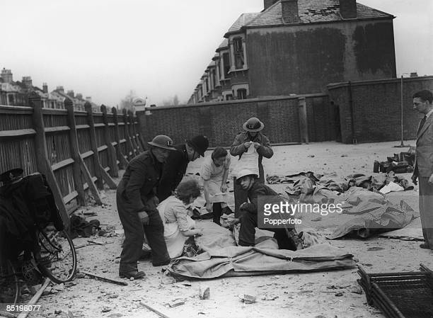 The bodies of some of the 45 children killed in a direct hit on a London school during a World War II bombing raid 21st January 1943 More are feared...