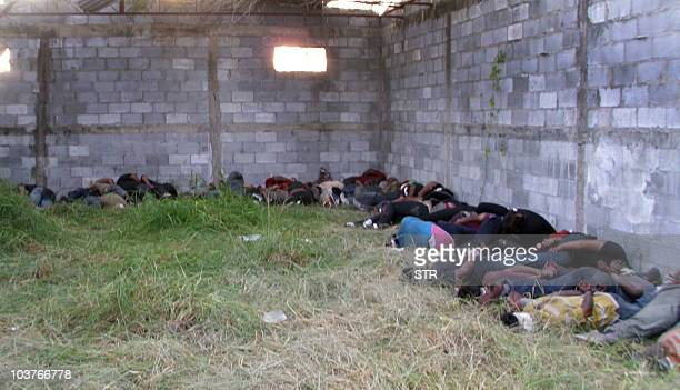 The bodies of some of the 72 migrants killed in a ranch in Mexico lie on the ground at an abandoned warehouse in San Fernando Tamaulipas state Mexico...