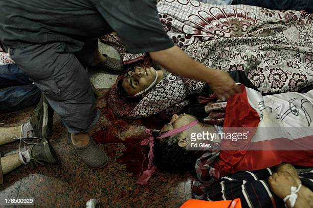 The bodies of supporters of deposed Egyptian President Mohammed Morsi lie on the floor of the Rabaa al-Adaweya Medical Centre in the Nasr City...