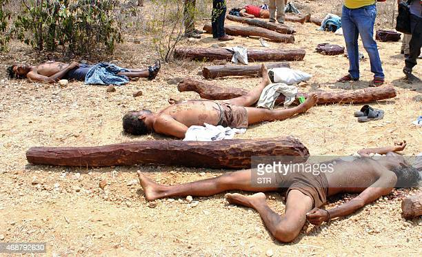 The bodies of suspected sandalwood smugglers who were killed in an encounter with a joint team of special police and forest personnel lie in the...
