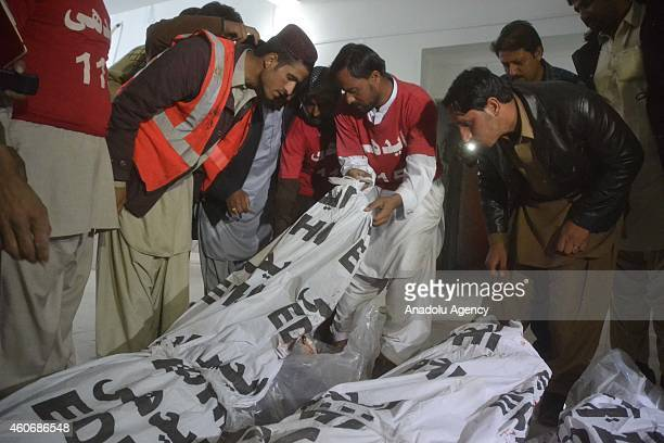 The bodies of TehrikiTaliban Pakistan militants are seen in a hospital in Quetta Pakistan on December 19 2014 Pakistani security forces on Friday...