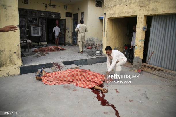 TOPSHOT The bodies of Tersem Lal and his wife Manjeet Kour who were killed during cross border firing between India and Pakistan lay on the ground in...