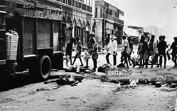 The bodies of those who were killed in the riots in New Dehli are loaded in trucks during a lull in the fighting