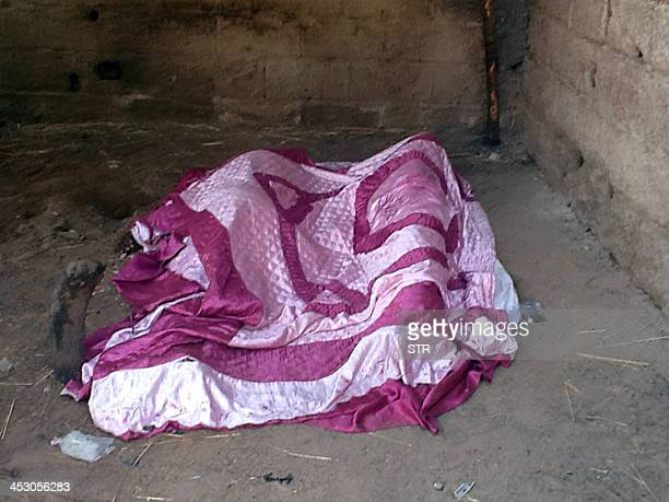 The bodies of two brothers reportedly shot by Boko Haram pictured in their house in Ngomari opposite the Air Force base in Maiduguri on December 2...
