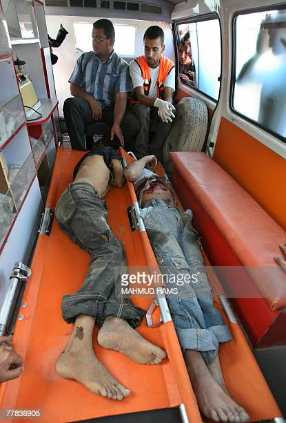 The bodies of two Palestinain youths lie on stretchers in an ambulance outside alShifa hospital in Gaza city 10 November 2007 Two Palestinians were...