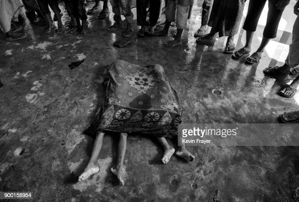 COX'S BAZAR BANGLADESH SEPTEMBER 29The bodies of two Rohingya refugee children are seen covered prior to burial after a boat capsized killing dozens...