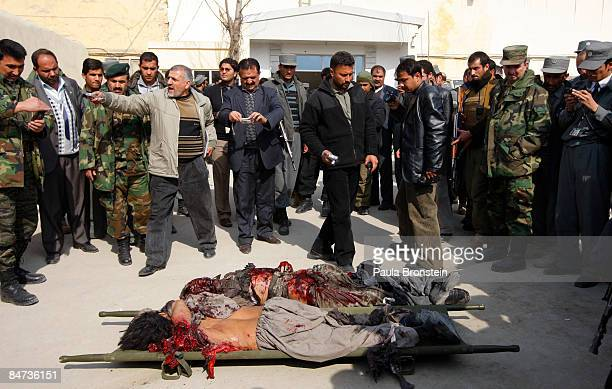 The bodies of two suicide bombers are taken out of the Ministry of Justice after Taliban militants attacked three government buildings in the Afghan...