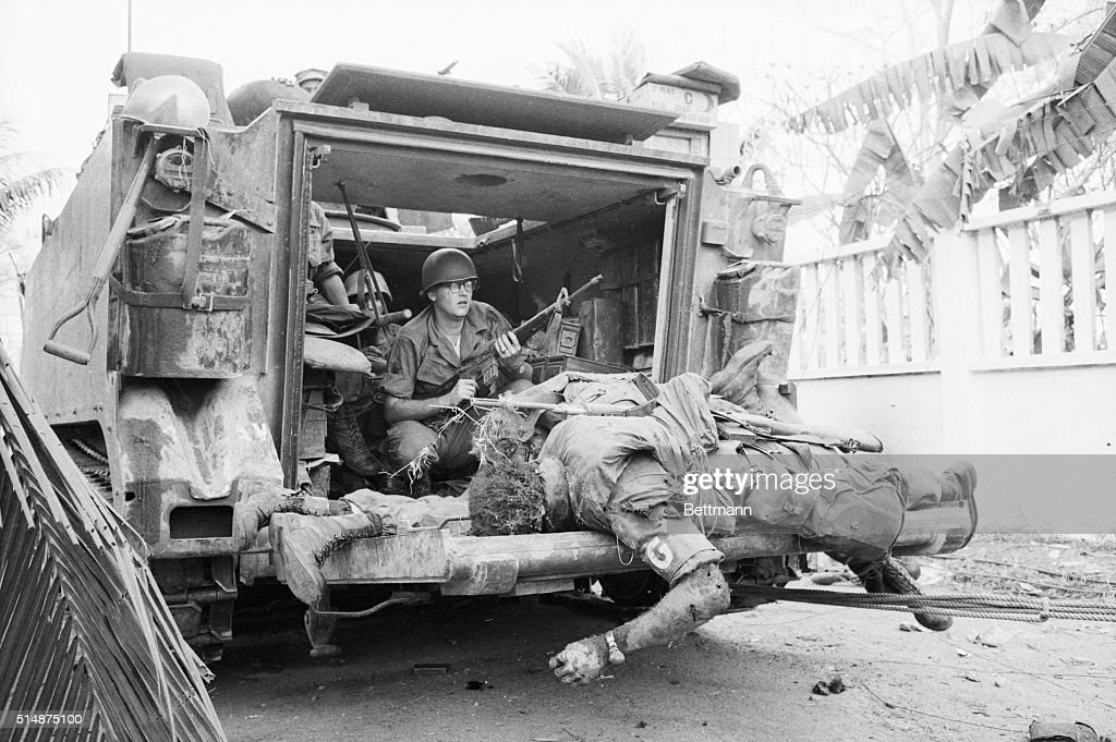 The bodies of US soldiers lay on the back of an armored personnel carrier which moved through the fighting near Tan Son Nhut Airbase to pick up the dead. | Location: Near Tan Son Nhut Airbase, Saigon, South Vietnam.
