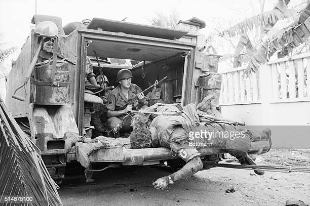 The bodies of US soldiers lay on the back of an armored personnel carrier which moved through the fighting near Tan Son Nhut Airbase to pick up the...