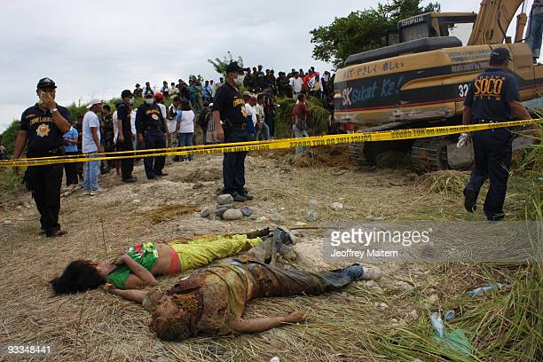 The bodies of victims are recovered following the massacre of at least 30 kidnap victims on Monday in Ampatuan town on November 24 2009 in...