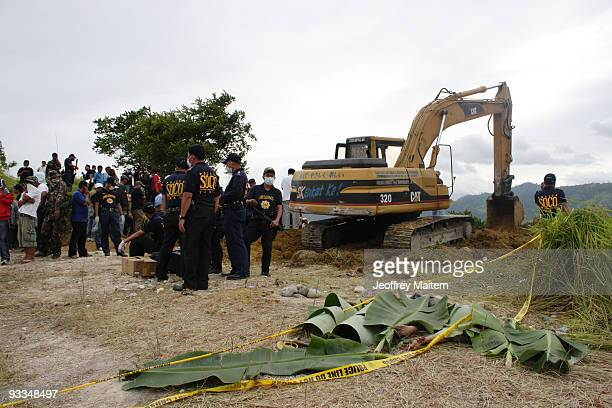 The bodies of victims are recovered following the massacre of at least 46 kidnap victims on Monday in Ampatuan town on November 24 2009 in...
