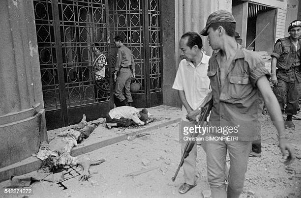 The bodies of victims of a rocket attack lie in front of a building at 213 Tu Do Street in Saigon during the Tet Offensive